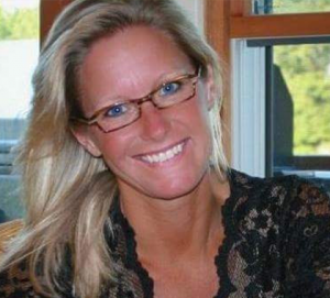 photograph of patient experience coordinator Randi McCracken Northman smiling in our office